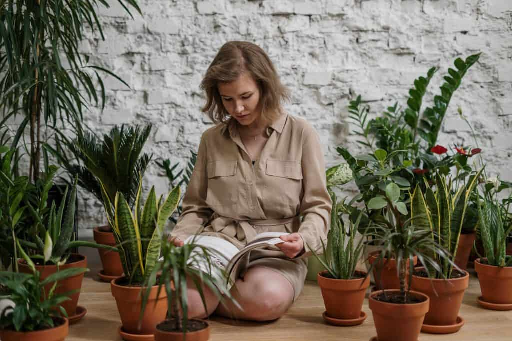 Woman Reading Book with Plants